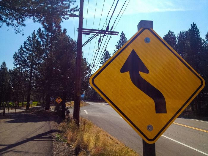 Turn sign on a fall afternoon, in Truckee. Blue Sky California Information Sign On The Road Pine Trees Power Lines Road Sign Sign Signs Street Sign Truckee  Warning Sign