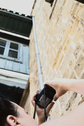 Woman Shooting Taking  Photo Exterior Building Art Shapes Human Hand Photography Themes Close-up Architecture Building Exterior Built Structure Street Art Residential Structure Camera - Photographic Equipment Photographer SLR Camera Lens - Optical Instrument Photographic Equipment Digital Single-lens Reflex Camera Camera Paparazzi Photographer Photographing Digital Camera