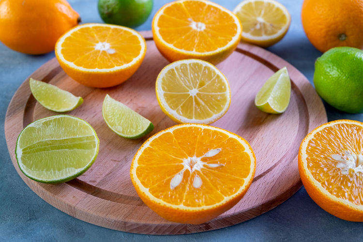Close-up of orange fruits on cutting board
