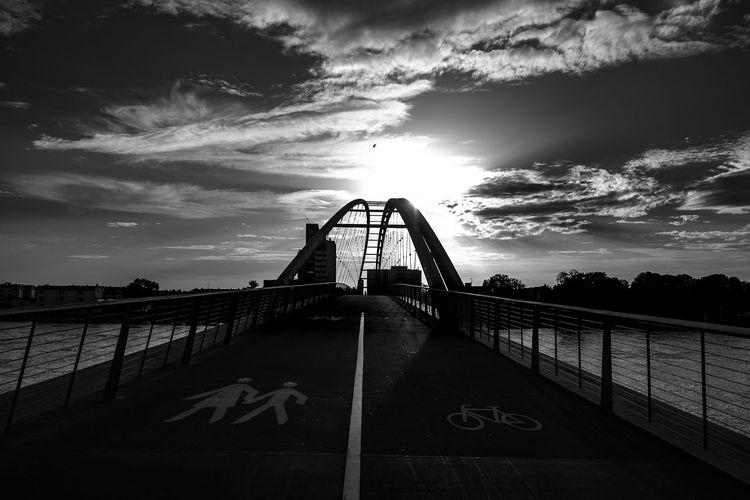 Three countries bridge over rhine river at weil am rhein against sky