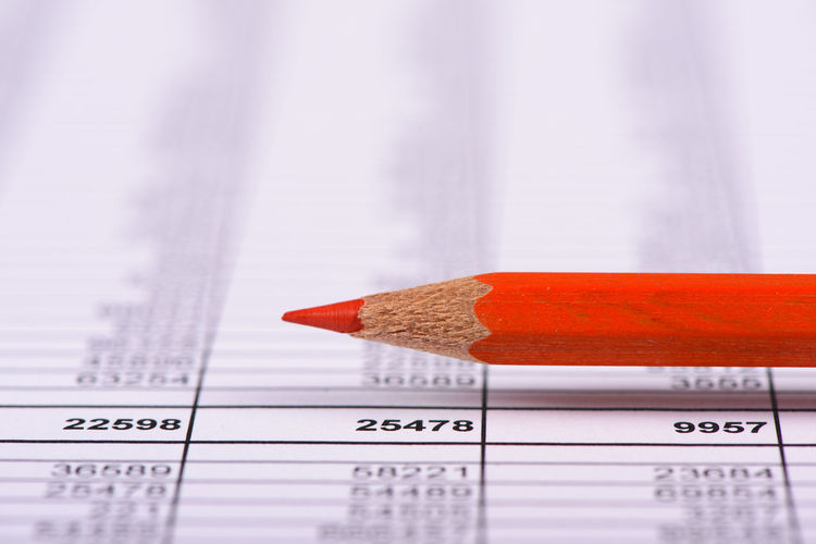 red pencil laying over spreadsheet with financial data Business Economy Revenue Account Analysis Business Finance And Industry Calculation Economic Expenses Finance Finance And Economy Financial Financial Figures Income No People Paper Pencil Red Pencil Report Savings Spare Spreadsheet Stock Market Stock Market And Exchange Stock Market Data