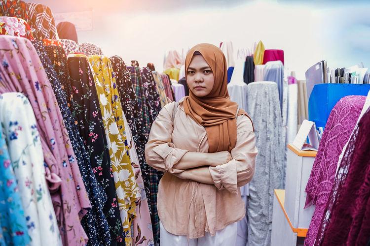 Panoramic shot of woman looking at store