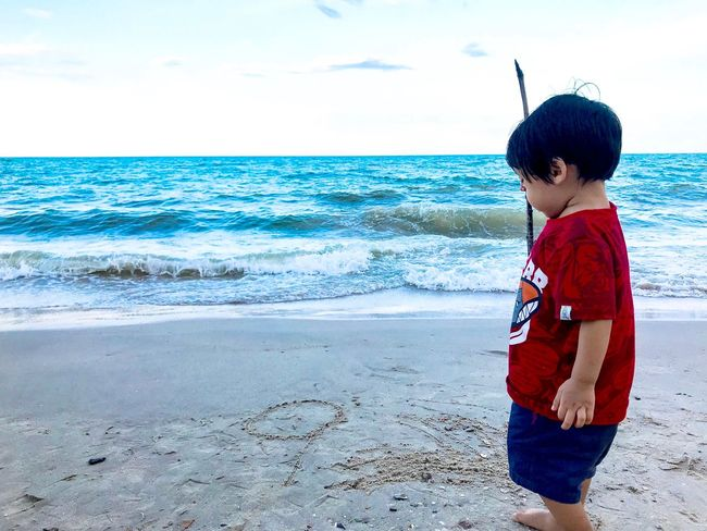 Little boy playing sand beach Relaxing Playing Kids Blue Writing People Family Life Is A Beach Travel Sea Water Beach Land Horizon Over Water Horizon Child Real People Sky Childhood Sand Boys One Person Outdoors Leisure Activity Nature Beauty In Nature Scenics - Nature Lifestyles Day