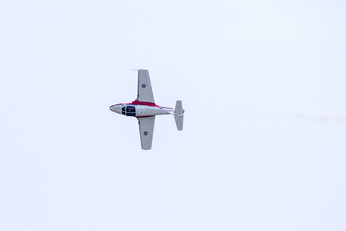 Aerospace Industry Air Vehicle Airplane Clear Sky Copy Space Day Fighter Plane Flying Low Angle View Mid-air Mode Of Transportation Motion Nature No People on the move Outdoors Plane Sky Transportation Travel White Color