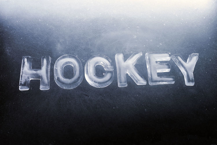 "Word ""HOCKEY"" made of real ice letters. Text Single Word Writing Cold Temperature Hockey Ice Hockey Sports Indoors"