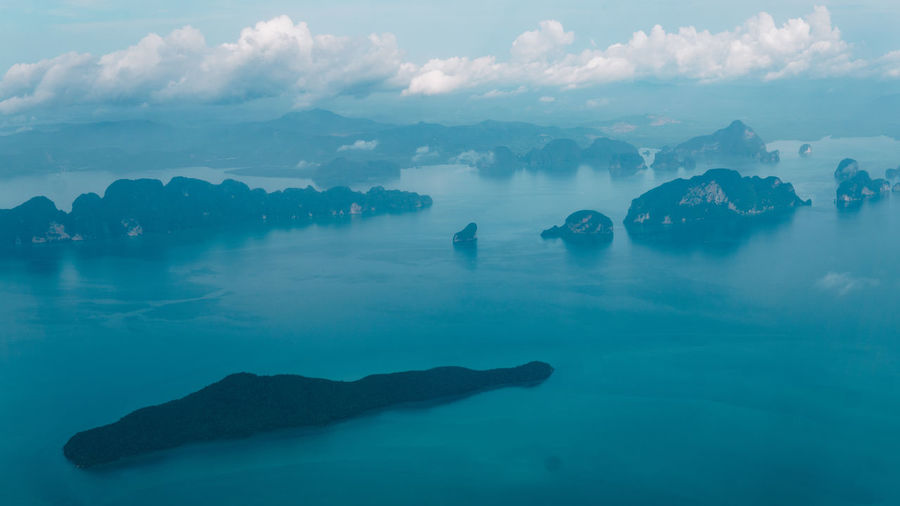 Island Seascape From An Airplane Window Clouds And Sky Water Sea Mountain Underwater Silhouette Sky Cloud - Sky Calm Horizon Over Water