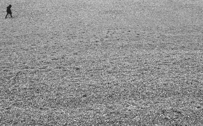Walking alone on a shingle beach in the UK. Alone Backgrounds Beach Black And White British British Beach By Myself Composition Day Empty Space English Beach EyeEmNewHere Lonliness Monochrome No People One Person Outdoors Reflection Shingle Shingle Beach Spaces Stones Stony Beaches Texture Walking