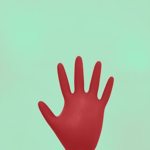 Close-up of hand against blue background