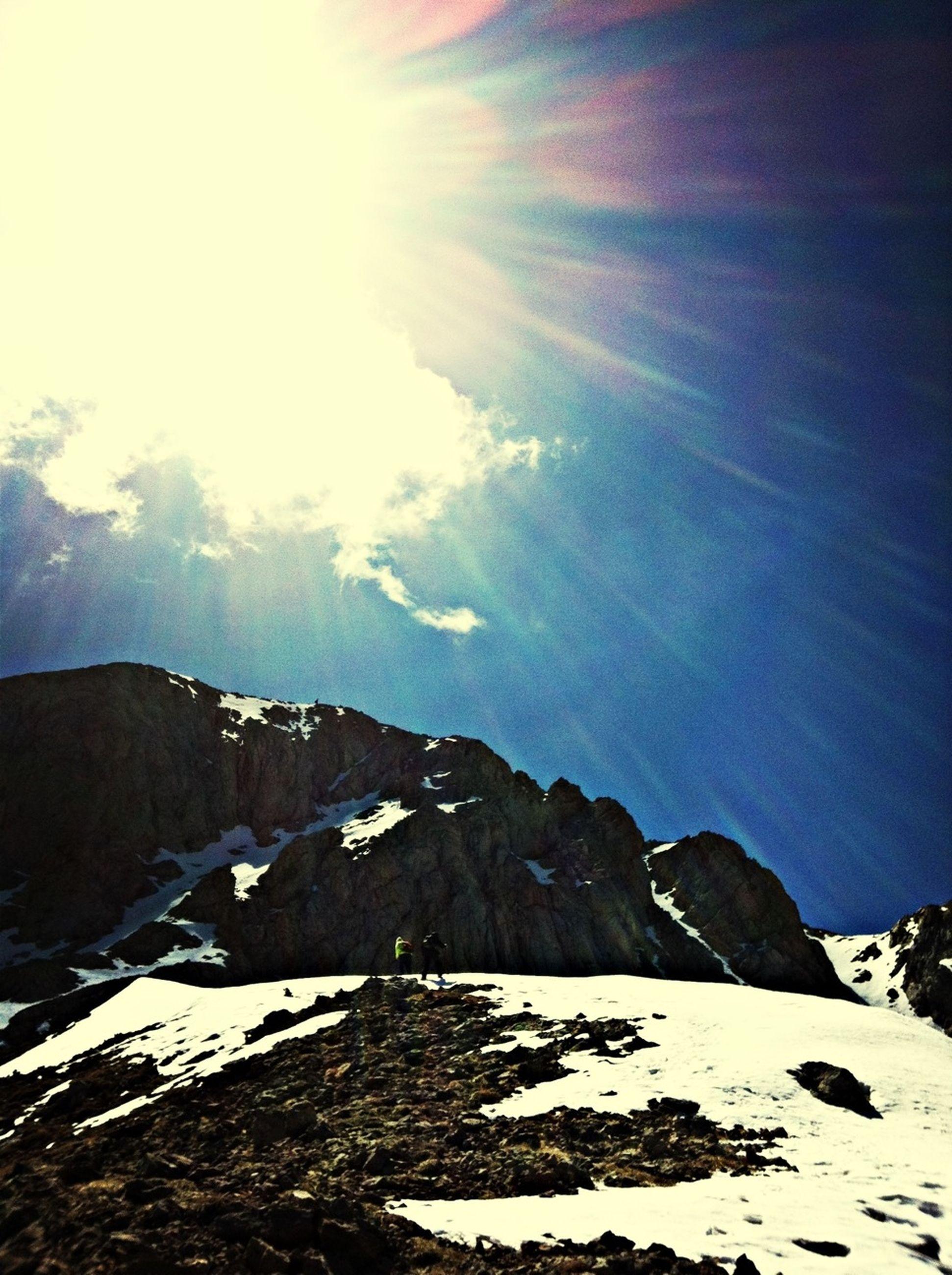 mountain, snow, tranquil scene, sky, tranquility, scenics, winter, beauty in nature, nature, cold temperature, mountain range, sunlight, landscape, cloud - sky, weather, sun, season, idyllic, non-urban scene, snowcapped mountain