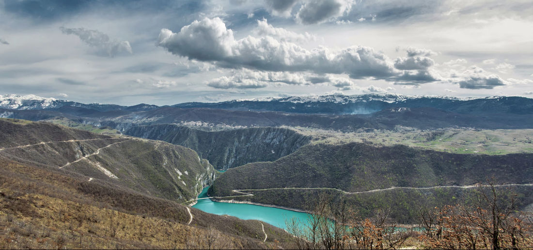 Balkans Scenics - Nature Cloud - Sky Beauty In Nature Mountain Tranquil Scene Sky Non-urban Scene Nature Day Mountain Range Outdoors Tranquility Balkans Montenegro River Landscape Environment No People Water Travel Destinations Physical Geography Idyllic