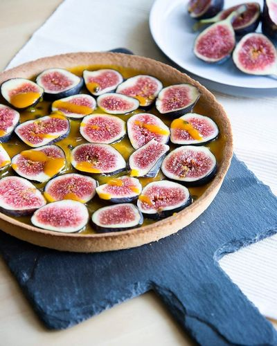 High Angle View Of Raw Fig Tart On Table