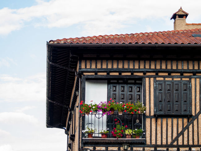 City Home Reflection Rural Architecture Architecture Building Building Exterior Built Structure Cloud - Sky Day Facade Building Facade Detail Flower Flower Head Flower Pot Flowering Plant Glass Growth House Low Angle View Nature No People Outdoors Plant Pot Pot Plant Potted Plant Residential District Roof Roof Tile Rural Building Rural House Sky Spring Springtime Urban Urban Life Window Window Box Window Frame Window Reflections
