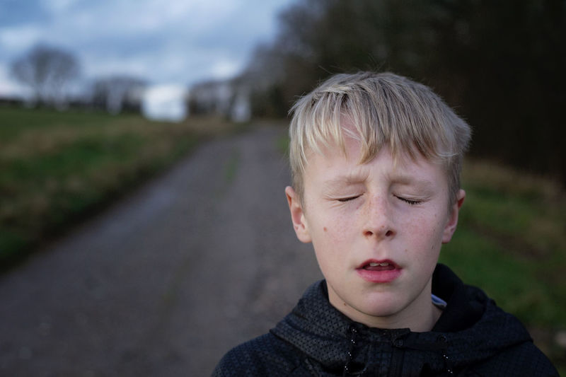 Thinking Eyes Closed  Thinking Atmospheric Mood Blond Hair Boys Child Childhood Children Only Close-up Countryside Day Focus On Foreground Headshot Moody One Boy Only One Person Outdoors People Real People