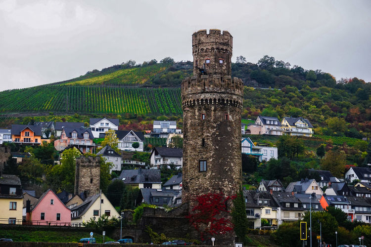 Low angle view of historic tower at oberwesel against mountain