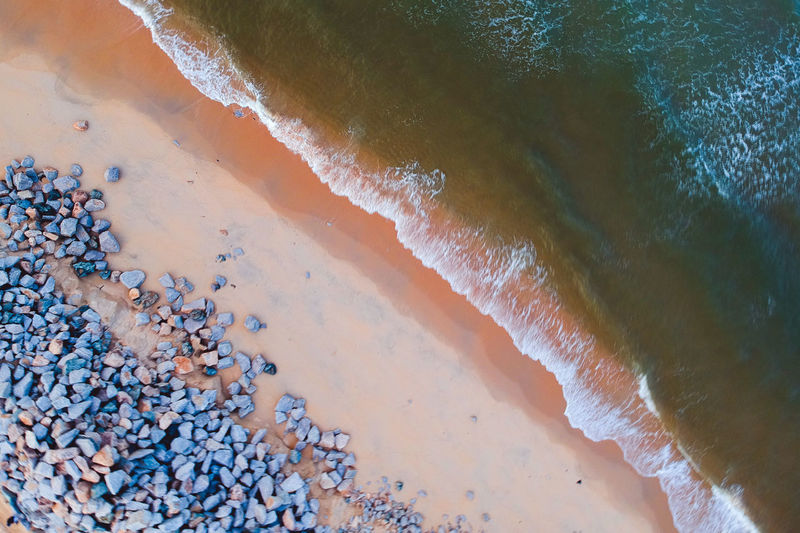 Close-up Aerial View Sea Sand Beach Sand Dune Wave No People Water Aquatic Sport Land Motion Nature Day High Angle View Sport Beauty In Nature Outdoors Reaching Full Frame Pebble