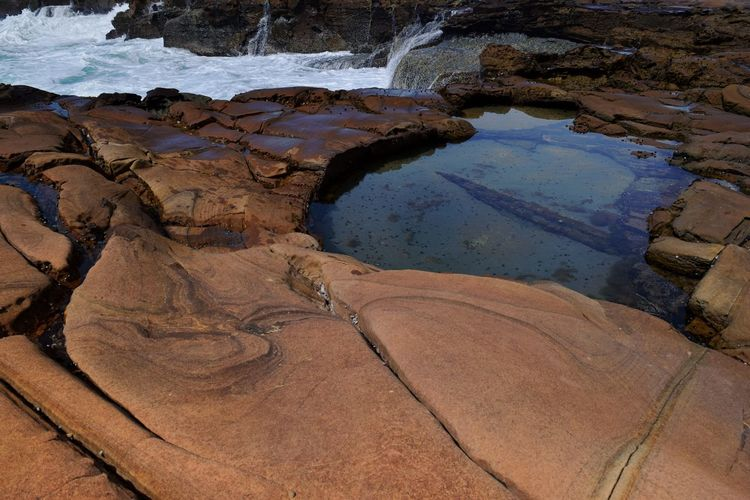Translucent Rock Pool EyeEmNewHere Water Beach Sand High Angle View Full Frame Close-up Geology Rock Formation Physical Geography Sandstone Rock Puddle Shore Seashell Eroded Rock Hoodoo
