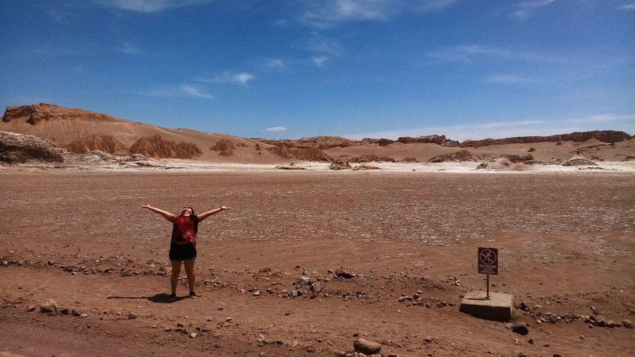 Woman Standing On Desert Against Sky