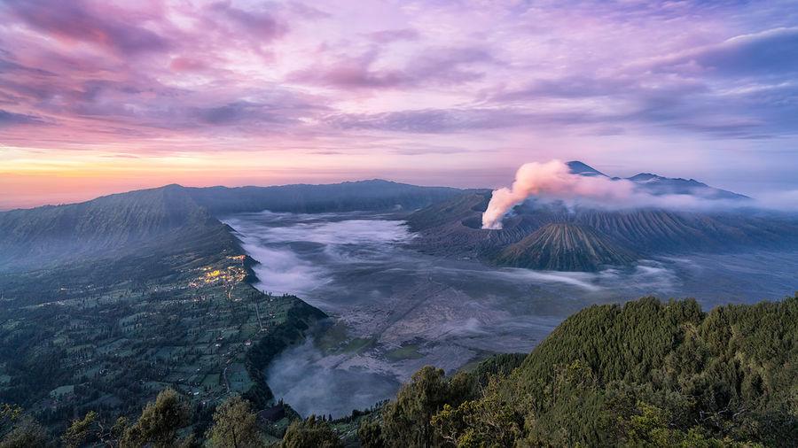 Volcanic landscape against sky during sunset