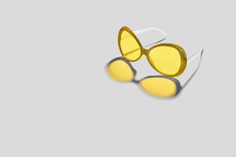 High angle view of yellow paper over white background