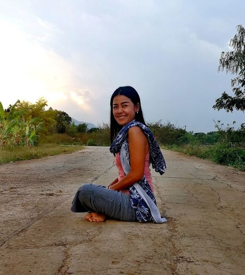 Womam Sitting Looking At Camera Smiling Children Only Full Length Sky People One Person Outdoors Thailand🇹🇭 2018 Day EyeEmNewHere Tranquility Beauty❤