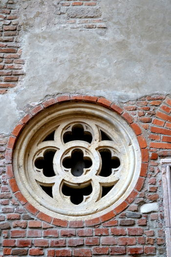Architecture Cathedral Past Rosone Della Cattedrale Wall Architectural Detail Architecture Brick Wall Building Exterior Built Structure Close-up Day Detail Italy No People Outdoors Outside Red Sculpture Tire Travel Destinations Wall - Building Feature Window