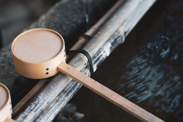Close up Japanese wooden ladle in temple Wood - Material Ladle Bamboo - Material Belief Outdoors Shrine Flowing Water Close-up Japan Japan Culture Japanese Culture Chozu Buddhist Temple Fountain Oriental Tradition Purity Clean Washing Shinto Temple