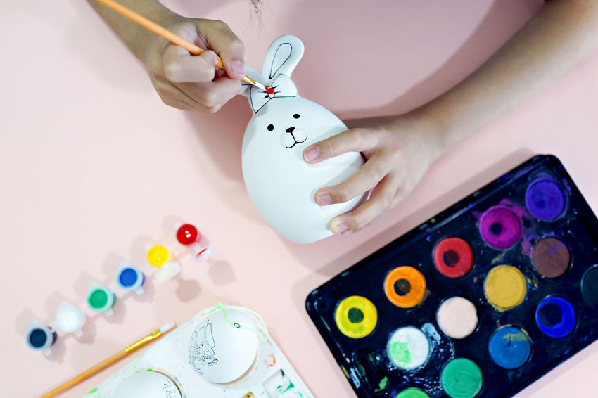 Kid painting on easter eggs. Art And Craft Coloring Easter Eggs Kids Paint Art Art And Craft Art And Craft Equipment Brush Bunny  Color Craft Creativity Education Happy Easter Kids Having Fun Painting Palette Pallete Rabbit Water Color