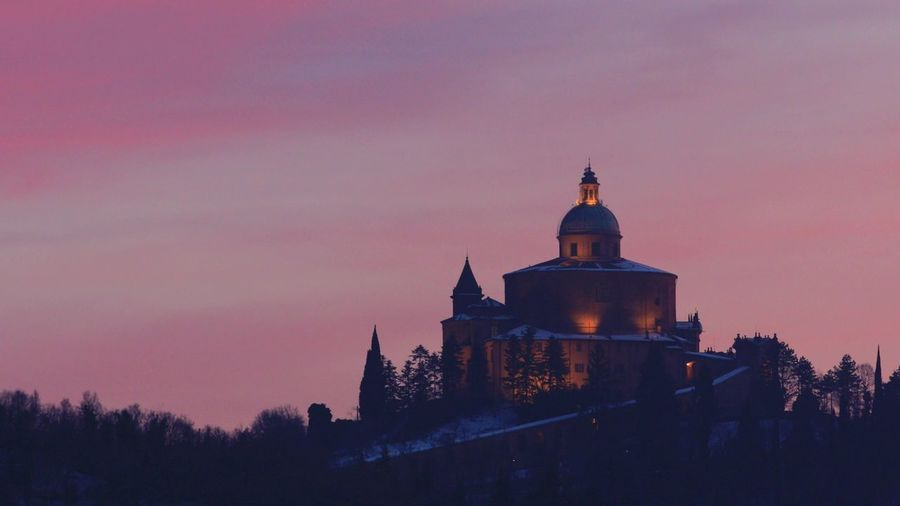 Distant view of Sanctuary of Blessed Virgin of San Luca on Colle della Guardia in Bologna. Twilight in the winter snow, pink sky with Copy space. Historical church and pilgrimage destination in Italy. Bologna Bologna, Italy Italy San Luca San Luca's Church San Luca Bologna San Luca Skyline Church Cathedral Basilica Night Sunset Religion Dome Madonna Holy Mary Holy Virgin Madonna Di San Luca Dawn Building Exterior Sky Built Structure Architecture Place Of Worship Tree Spirituality Belief Building Illuminated Nature Plant Travel Destinations No People Dusk The Past History Purple Spire
