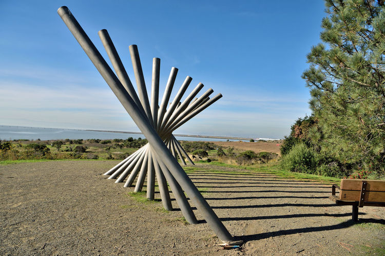 Rising Wave 8 Oyster Bay Pt. San Leandro, Ca. 16 Poles Stainless Steel Sculpture Sculptor : Roger Berry Rising Wave All About Angles Is It Art? Abstract Photography Abstract Landscape_Collection Landscape_photography Shadows Bench Boulder Trees Schrubs Scenic Lookout Oakland Airport Hilltop San Francisco Bay Trail Nature Outdoors Cloud - Sky