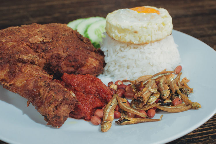 Malaysian cuisine, Nasi Lemak traditional malaysian spice rice dish with roasted chicken ASIA Cooking Cuisine Dinner Dish Lunch Menu Rice Tradition Close-up Day Egg Food Food And Drink Freshness Gourmet Indoors  Malaysia Malaysian Meat Nasi No People Plate Ready-to-eat Serving Size