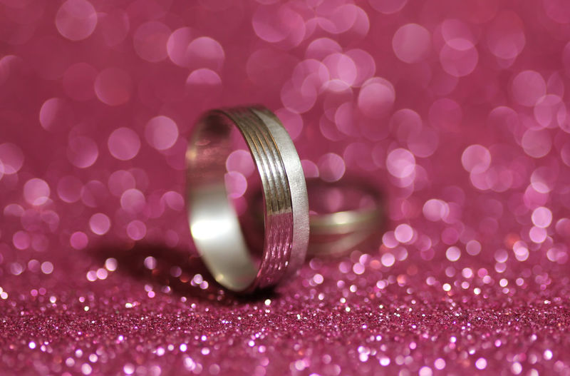 Close-Up Of Rings On Pink Glitters