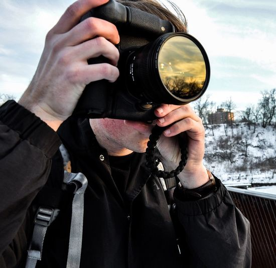 Close-Up Of Man Photographing With Camera During Winter