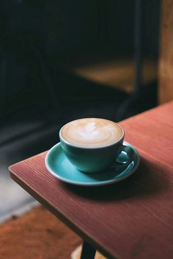 A flat white in porcelain cup