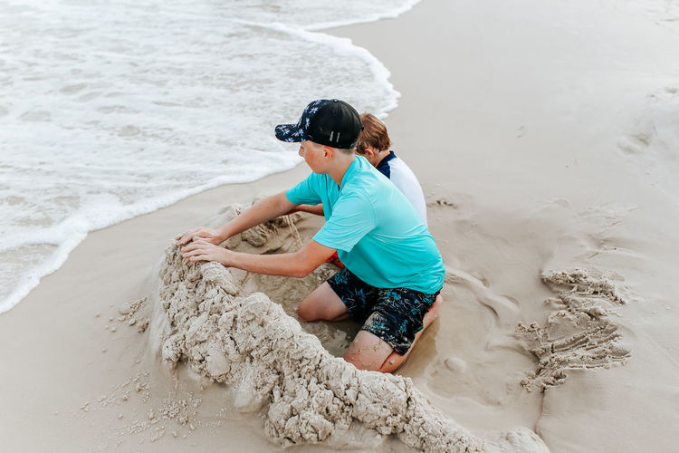 High angle view of woman sitting on beach