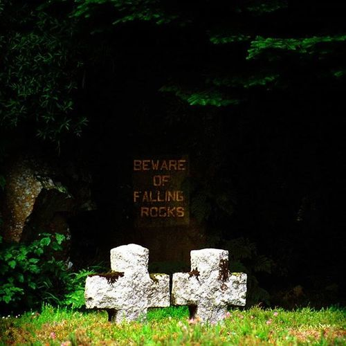 Beware of falling rocks Irony Cross Cemetery Death Sign Ireland Glencree Grass Green Clouds Colours Colors Travelgram Nature