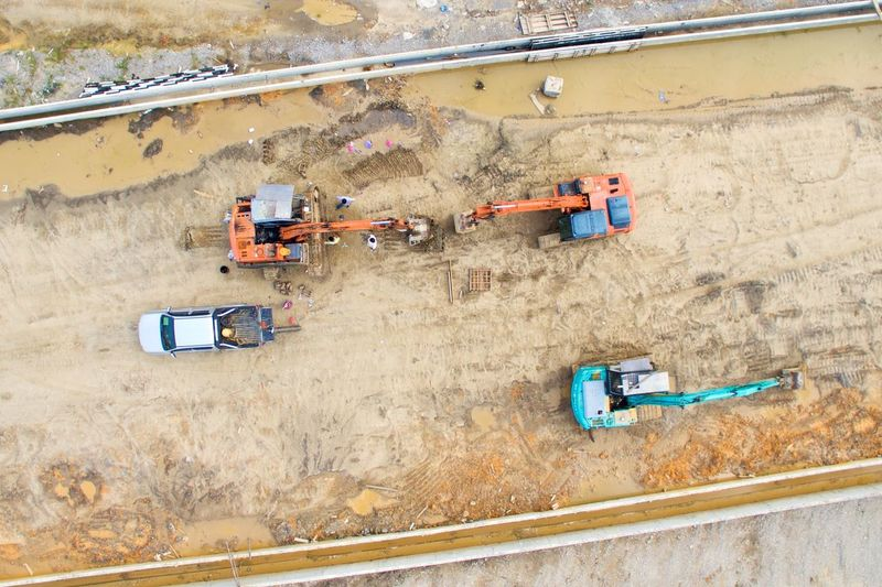 Aerial Shot Aerial View Construction Site Day Excavation Excavator Heavy Machinery High Angle View Industry No People Outdoors Working