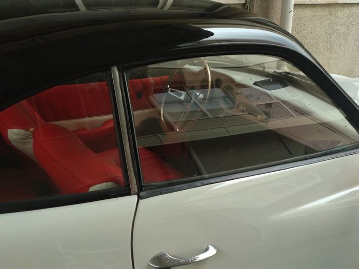 High angle view of reflection on side-view mirror of car