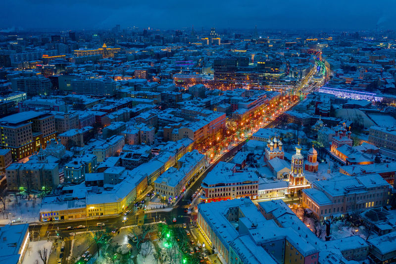 Aerial view of snow covered townscape at night