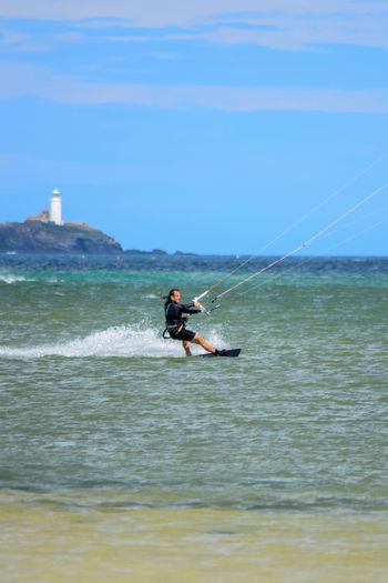 Kitesurfer enjoying cornish surf Godrevy Lighthouse Activities Having Fun Hobbies Kitesurfer With Godrevy Lighthouse In The Background Water Sea Sport Men Wave Athlete Sky Windsurfing Water Sport Extreme Sports My Best Photo