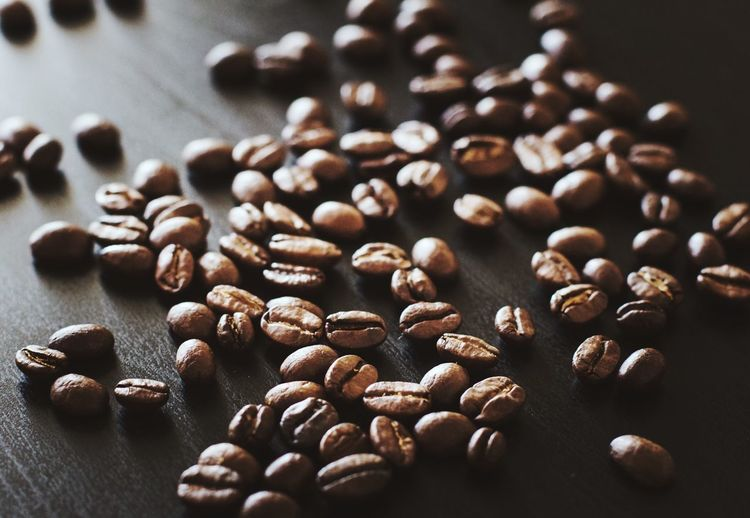 Close-Up Of Raw Coffee Beans On Table