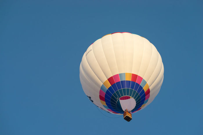 PUTRAJAYA, MALAYSIA - 12TH MARCH 2017; MyBalloon Fiesta in Putrajaya features colorful hot air balloon floats with over 15 balloonists from all over the world. Above The City Adrenaline Junkie Aerial View Basket Blue Sky Bonding Colorful Floating Flying High Freedom Fun Ride Hanging Out Happy Hot Air Balloons Morning Light NO FLY ZONE Putrajaya, Malaysia Recreation  Rope Sport Tourist Attraction  Transportation Traquility Travel Destinations Weather