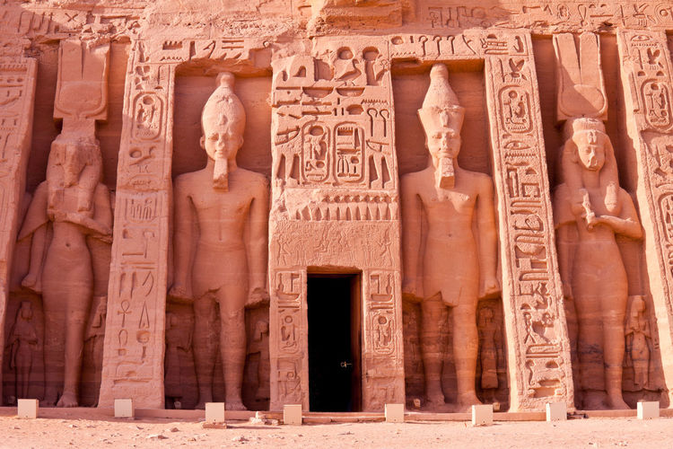 Temple of Hathor at Abu Simbel, Aswan, Egypt Abu Simbel Ancient Architecture Carving Cliff Culture Egypt Egyptian Enormous Excavation Exterior Famous Places Hathor Hieroglyphs History Landmark Pharaoh Queen Ramesses II Religion Religious  Rock Statues Temple Travel Destinations UNESCO World Heritage Site