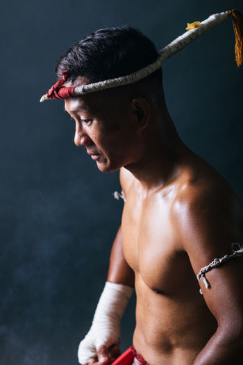 Boxer looking away against black background