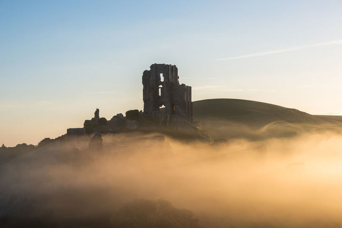 corfe castle in the early morning mist at sunrise Copy Space Dorset EyeEm Best Shots Tourist Attraction  Ancient Ancient Civilization Architecture Beauty In Nature Building Exterior Built Structure Corfe Castle Environment Fog History Mist Misty Morning Mountain Nature No People Outdoors Places To Visit Places You Must To See Ruined Scenics - Nature Sky Sunrise The Past Tourism Tourist Destination Tranquil Scene Tranquility Travel Travel Destinations