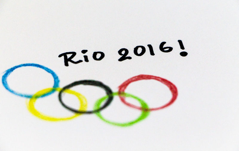 High Angle View Of Text And Olympic Rings Drawn On Paper