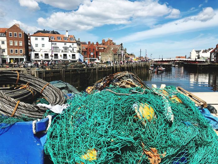 Gone fishing Whitby Harbour Whitby North Yorkshire Fishing Equipment Fishing Net Fishing Industry Fishing EyeEm Selects Architecture Water Sky Built Structure Building Exterior Cloud - Sky City Fishing Day Fishing Industry Transportation Nature Building Outdoors No People Mode Of Transportation Harbor Fishing Net Nautical Vessel