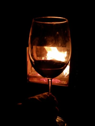 Joyful Moments Peaceful Tranquility Stove Woodfire Fire Wine Wineglass Alcohol Red Wine Drink Drinking Glass Indoors  Close-up