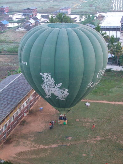 Balloon taking off Air Flight Balloon Basket Balloon Flight Composition Full Frame Green Colour Ground Crew Hot Air Balloon In Flight Inflated Balloons Inle Lake Lake Myanmar No People Outside Photography Shan State Tourism Tourist Attraction  Tourist Destination Tree