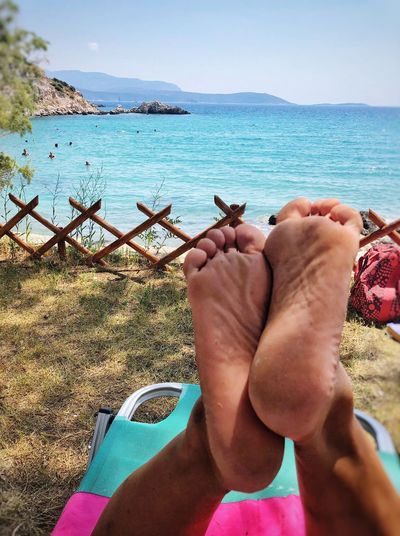 Holiday Summer Sea Beach Feet Water Sea Beach Real People Land Human Body Part Sky Personal Perspective One Person Leisure Activity Body Part Day Lifestyles Human Foot
