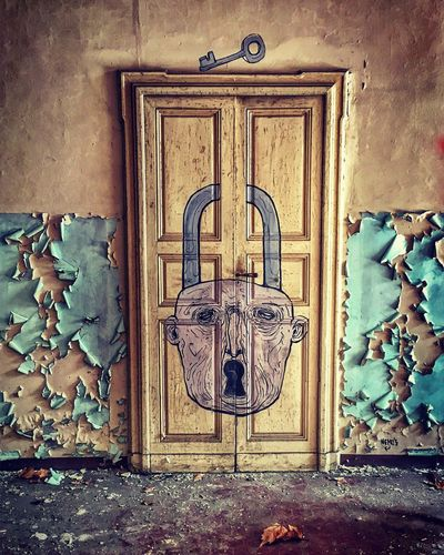 The secret door Door Closed Hanging No People Wood - Material House Built Structure Day Entry Architecture Outdoors Close-up Graffiti Mural Art WhoIsNemosArt